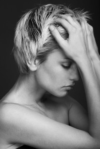 young-woman-looking-depressed-with-headache-202x300